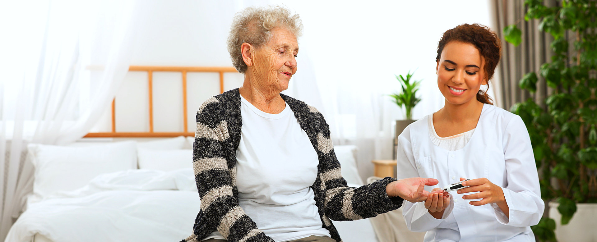 woman and senior woman talking to each other