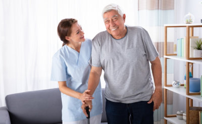 smiling senior man with nurse