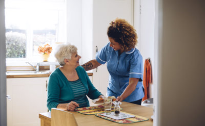senior woman with smiling nurse