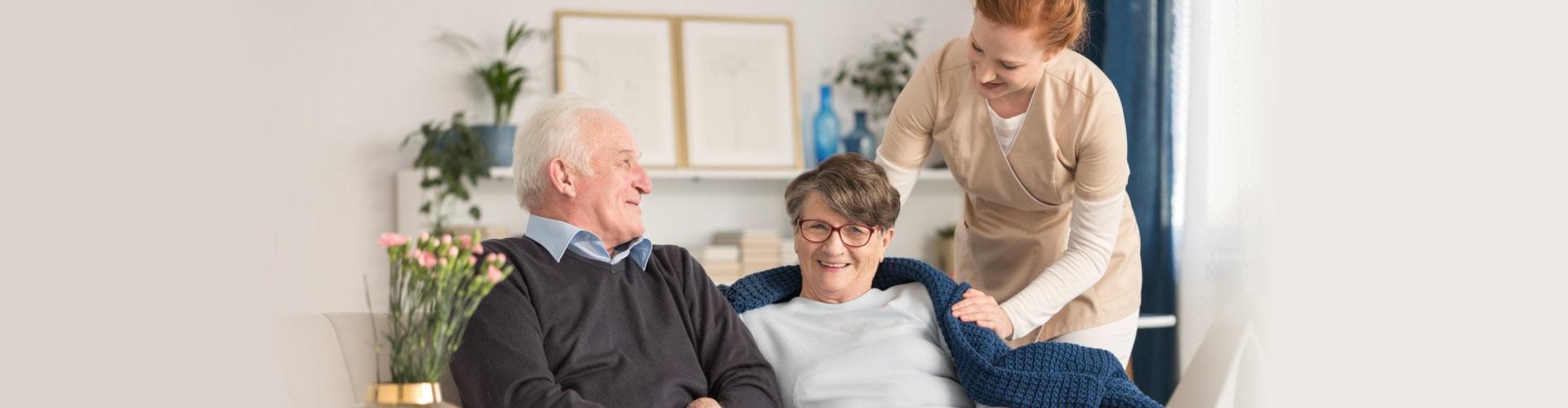 senior couple with nurse