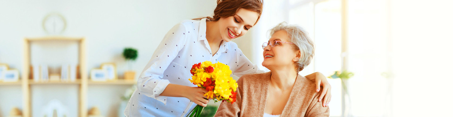 senior woman with young woman