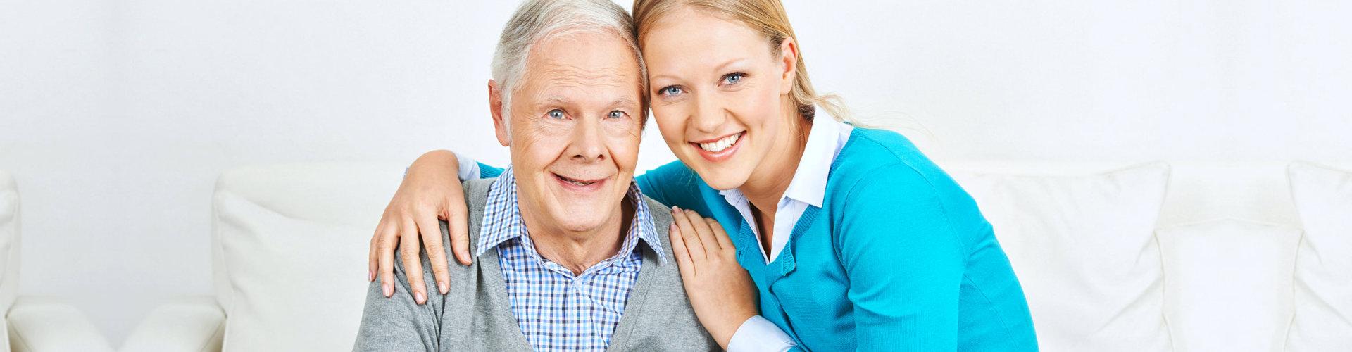 happy senior man with caregiver