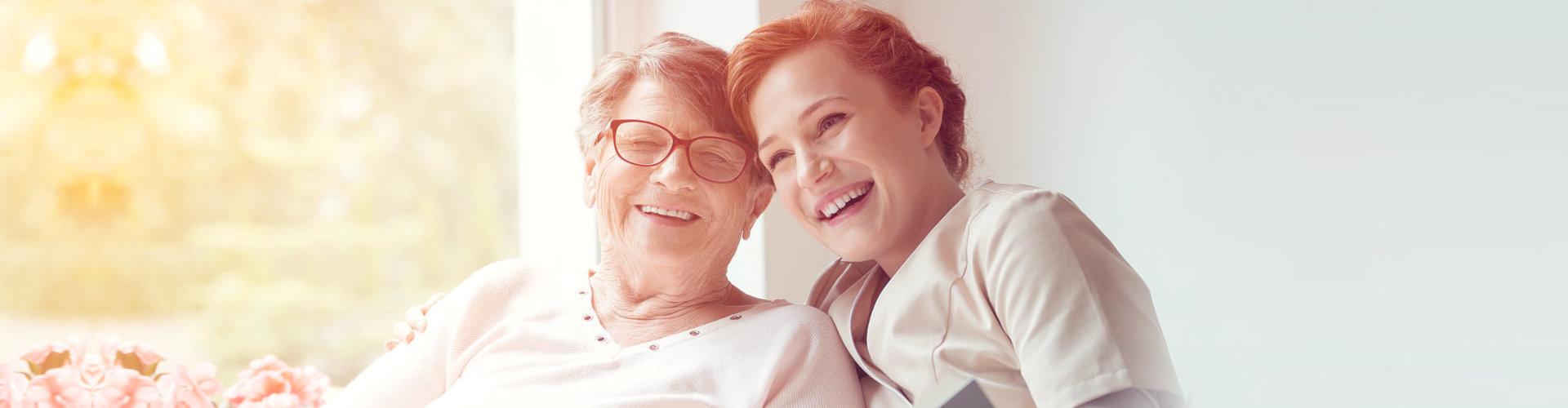 senior woman with happy nurse